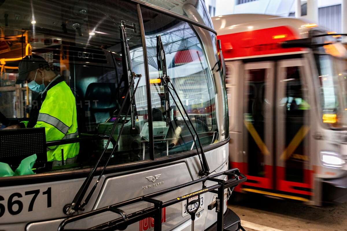 A Muni operator checks the bus before departing from the Salesforce Transit Center.
