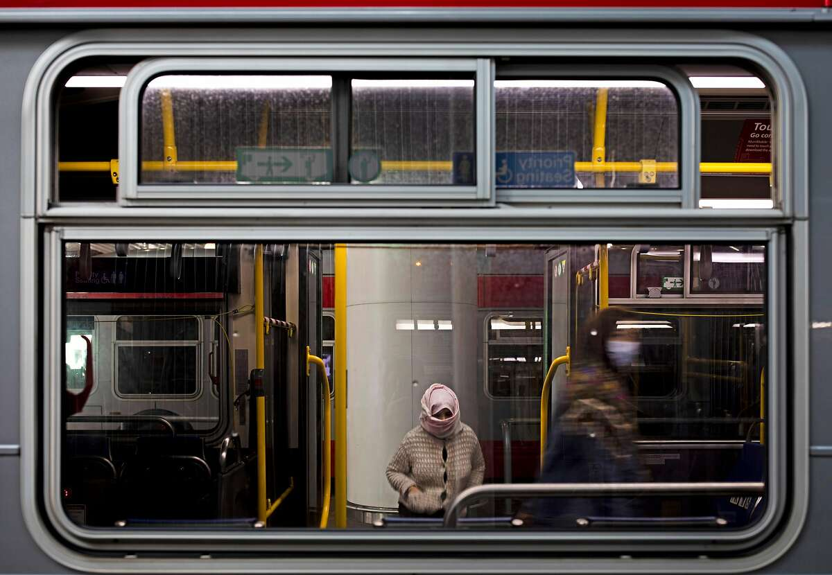 The only two passengers board a Muni bus that departs from Salesforce Transit Center, Thursday, Dec. 24, 2020, in San Francisco, Calif. The coronavirus pandemic led to a decline in public transportation ridership.