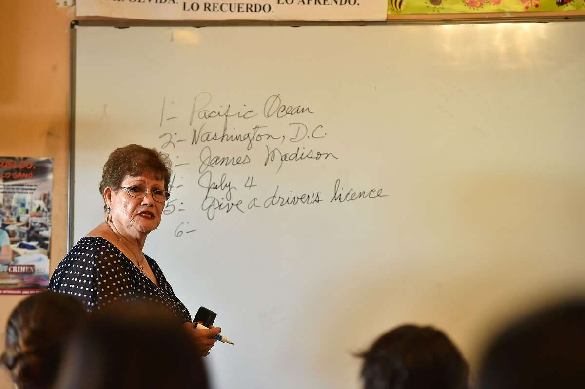 Maria Valenzuela, 75, reviews possible test questions with the help of fellow students during preparation for a U.S. citizenship class for immigrants in 2016 in Perris (Riverside County).