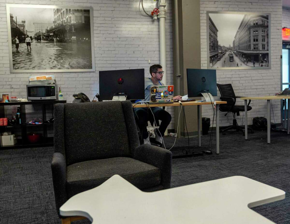 John Wondrak, a sales representative with Braustin Homes, works at the company's Geekdom offices recently.