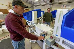 Klaus Weiswurm, Innovation Technology Machinery chairman, demonstrates the operation Thursday, Oct. 29 2020, of a machine developed at ITM for an insulated cooler maker. Weiswurm expects turbulent road in 2021 for U.S. manufacturers.