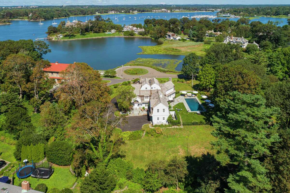 22 Cherry Tree Lane, Riverside, is a five-bedroom, 6,129-square-foot single-family home in the private waterfront association of Harbor Point. Berkshire Hathaway Home Services, New England Properties is the listing brokerage; the asking price is $7.25 million.