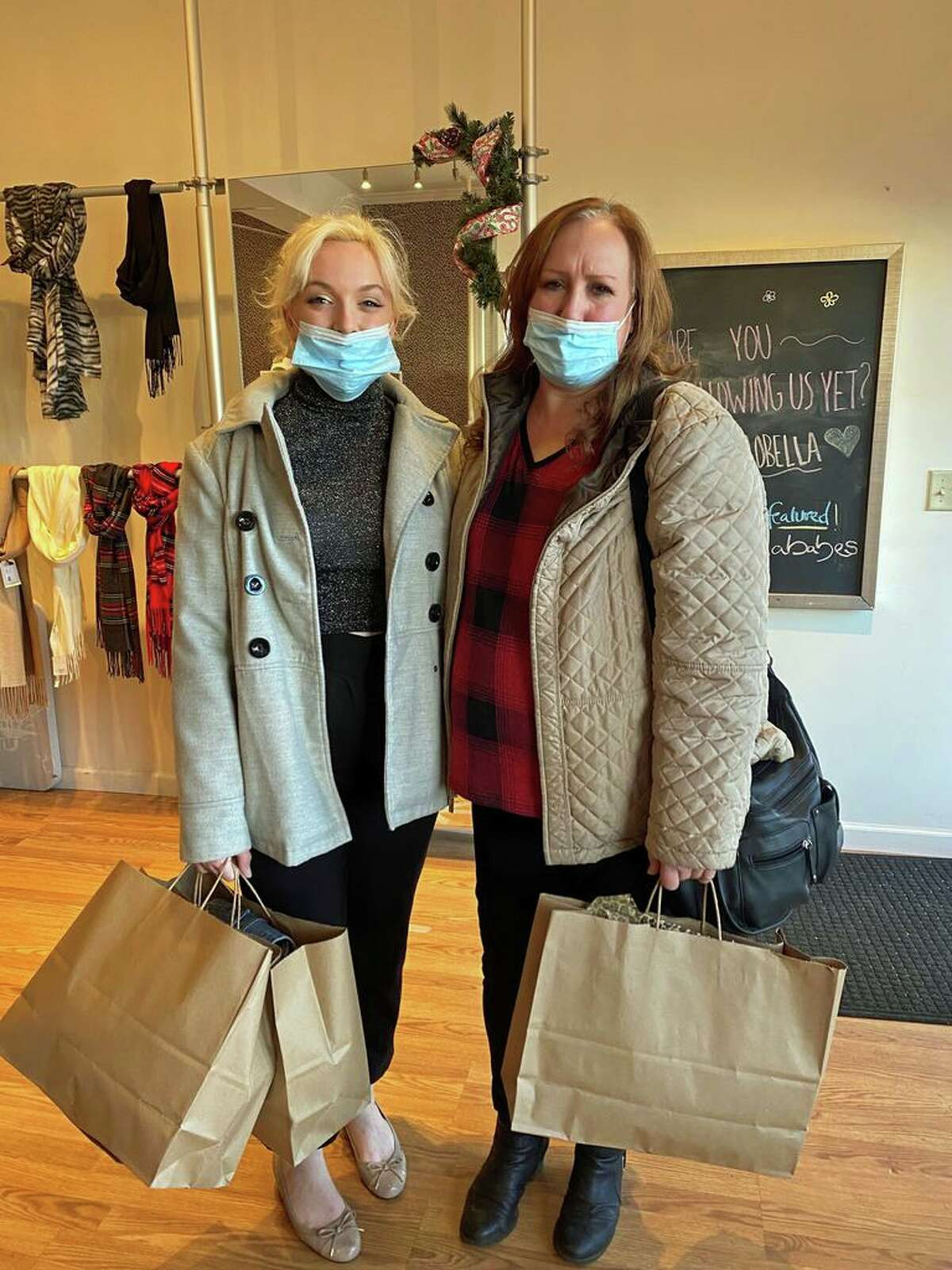 After a Christmas Eve fire displaced their family, Madeline Townsley, left, and her mother, Beth McDermott, were invited to shop at Madison's Ciao Bella for new clothes.