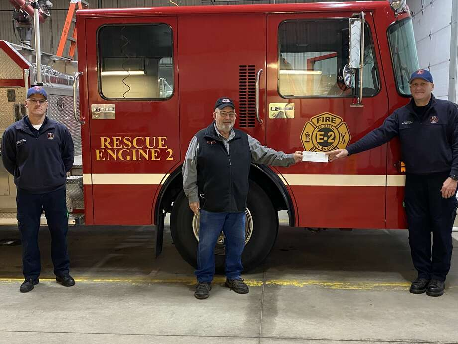 Pictured from left is Assistant Chief Alan Brennan, John Johnson of Cleveland Integrity Services, and Chief Ronald Palmer. Photo: Courtesy Photo