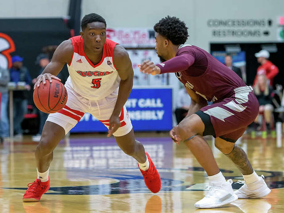 SIUE's Mike Adewunmi (left) drives on Eastern Kentucky's Jomaru Brown during a OVC men's basketball game last season at First Community Arena in Edwardsville. Because of the fluid nature of the season caused by the coronavirus pandemic, the Ohio Valley Conference has put contingency plans in place for the OVC Basketball Championship. Photo: SIUE Athletics