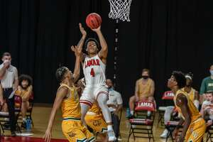 Cards Kasen Harrison (4) puts up a shot in the first half. Lamar University Cardinals men's basketball hosted the Southeastern Louisiana University Lions in a non-conference game at the Montagne Center Tuesday night. Photo made on December 29, 2020. Fran Ruchalski/The Enterprise