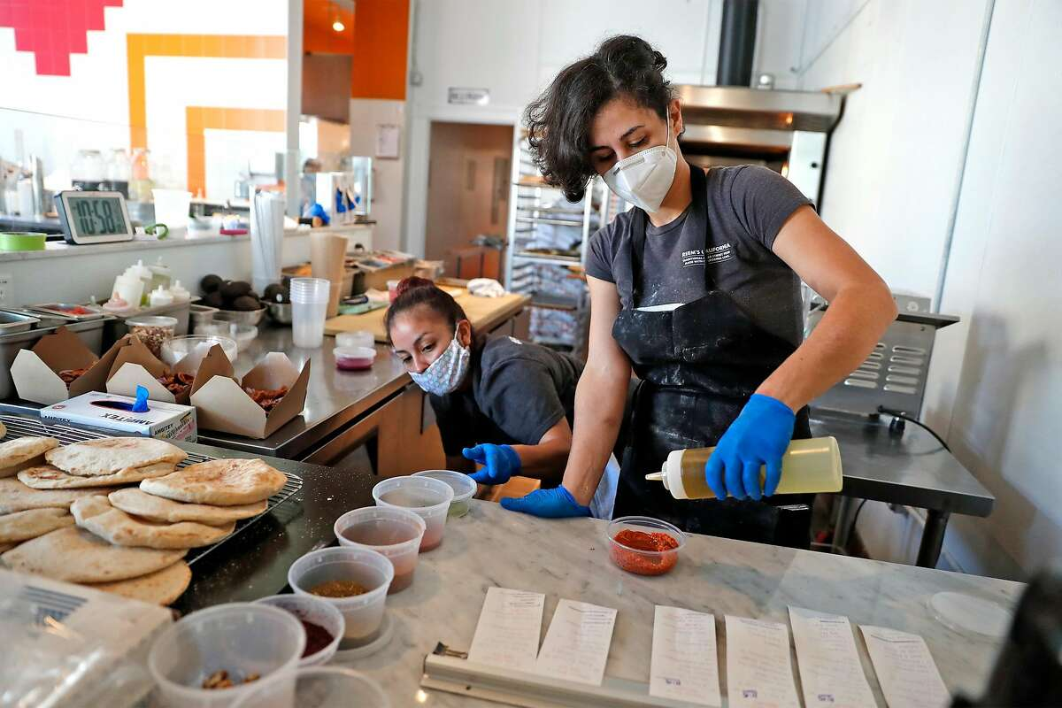 Chef and owner Reem Assil and Wendy Giron prepare food at Reem's California on Mission Street in San Francisco, California.