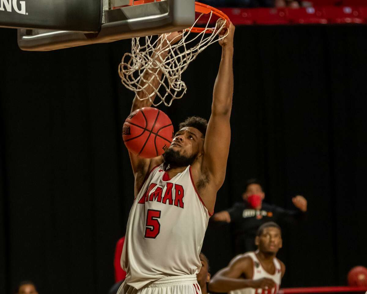 Cards Avery Sullivan (5) stuffs the ball home in the second half. Lamar University Cardinals men's basketball hosted the Southeastern Louisiana University Lions in a non-conference game at the Montagne Center Tuesday night. Photo made on December 29, 2020. Fran Ruchalski/The Enterprise