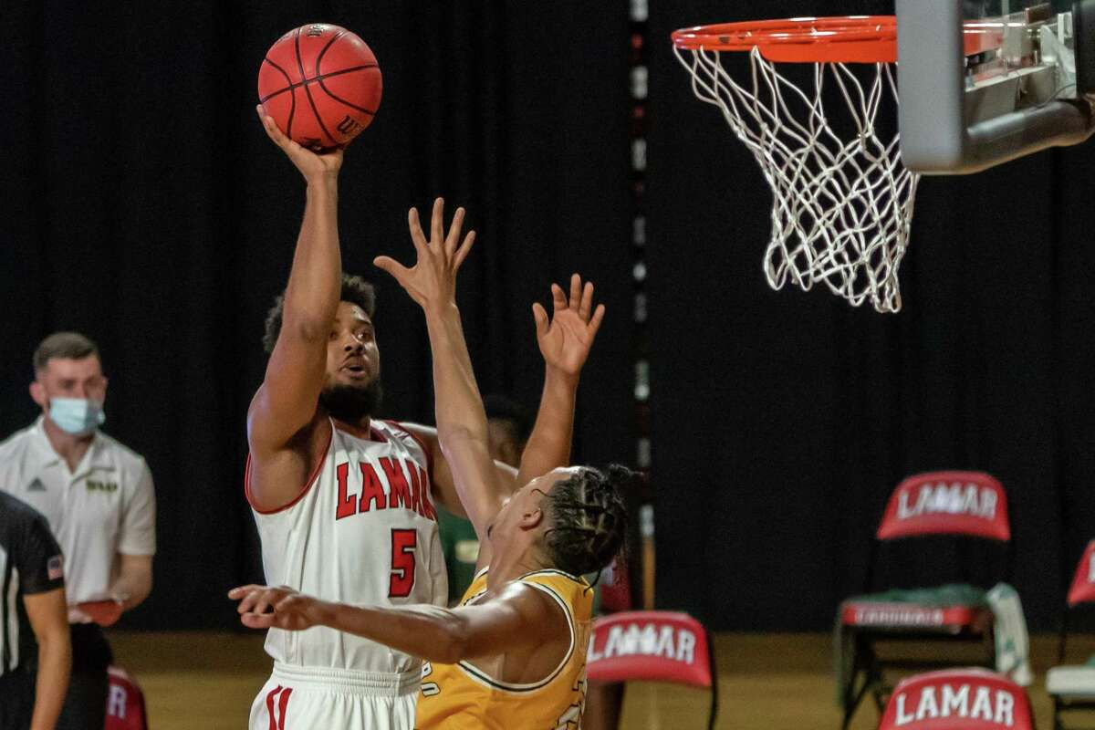 Cards Avery Sullivan (5) puts up a shot in the first half. Lamar University Cardinals men's basketball hosted the Southeastern Louisiana University Lions in a non-conference game at the Montagne Center Tuesday night. Photo made on December 29, 2020. Fran Ruchalski/The Enterprise