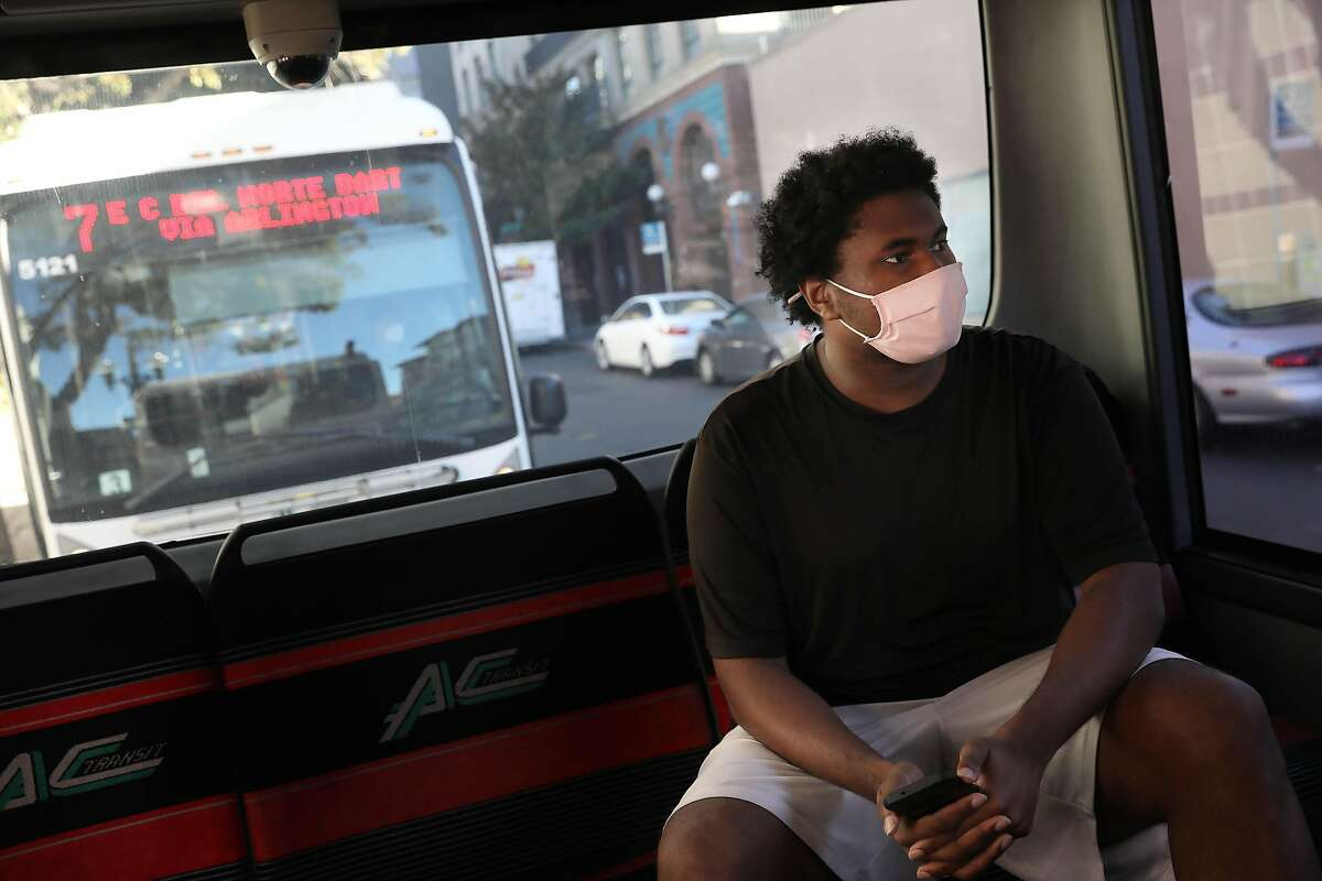 Darrell Owens, an East Bay Transit Riders Union member, waits for an AC Transit bus to depart.