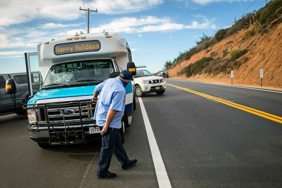 A Monterey Salinas Transit bus driver checks for traffic and vehicles pulling out of the parking area at Bixby Bridge outside Big Sur, Calif., on Tuesday, December 8, 2020.
