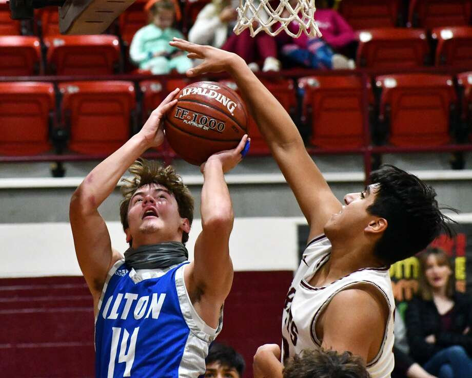 Olton's Bryson Ramage tries to get a shot off against the defense of Tulia's Alan Garcia during their non-district boys basketball game on Tuesday at Tulia. Photo: Nathan Giese/Planview Herald