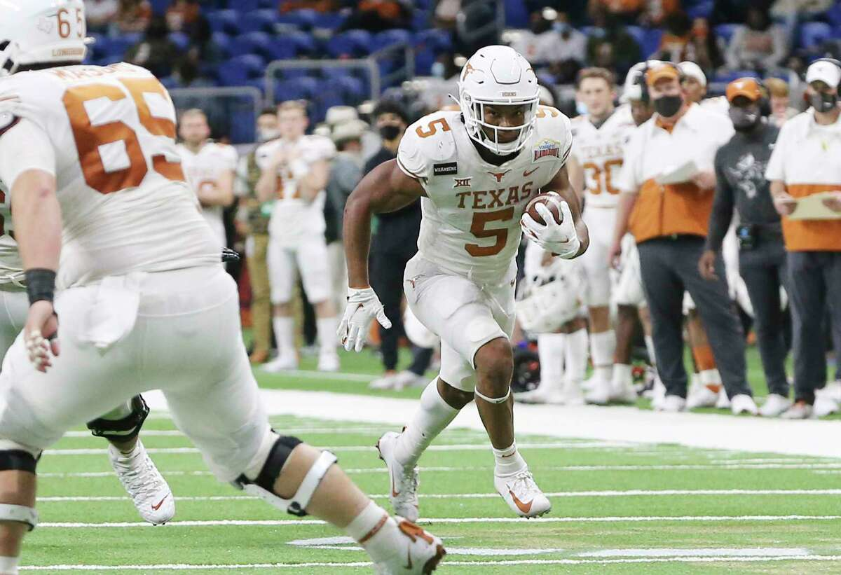 Texas' Bijan Robinson (5) runs in for his third touchdown against Colorado during the 2020 Valero Alamo Bowl on Tuesday, Dec. 29, 2020.