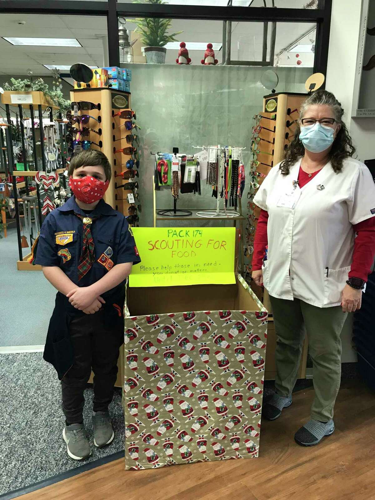 Hometown Pharmacy food donation box is collected by Scout Troop 174. (Submitted to Herald Review)