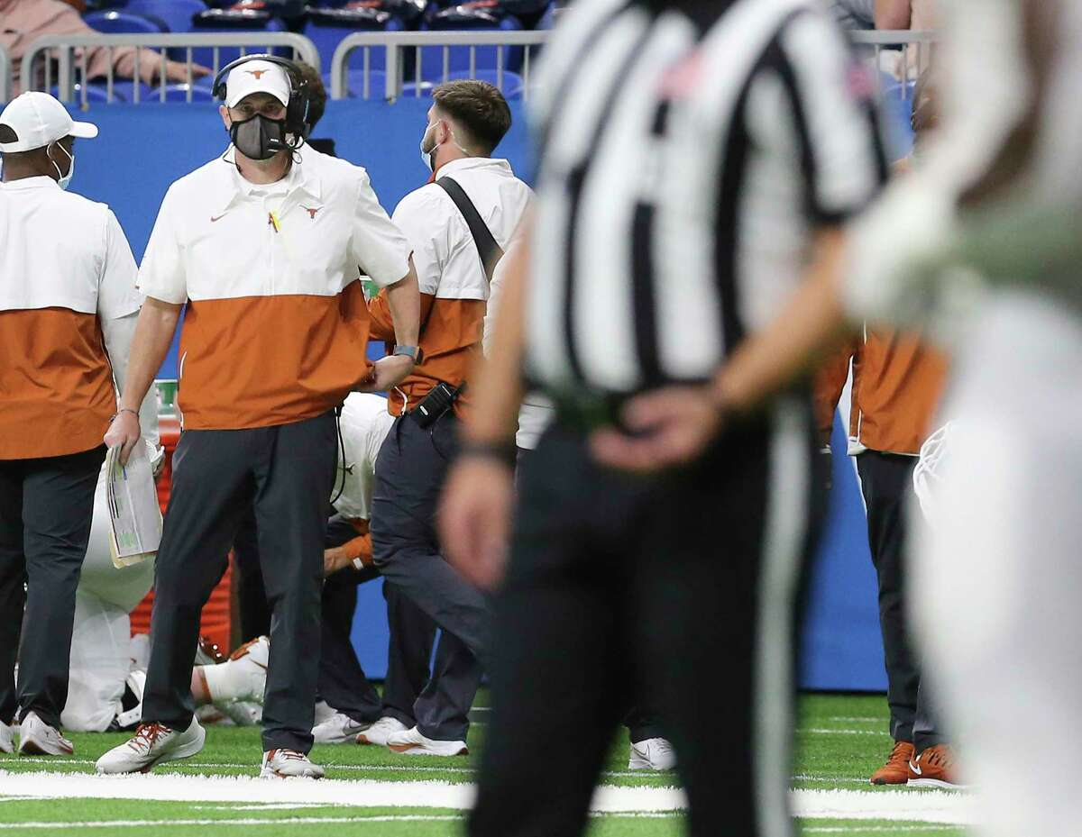 Texas head coach Tom Herman watches his team against Colorado during the 2020 Valero Alamo Bowl at the Alamodome on Tuesday, Dec. 29, 2020.