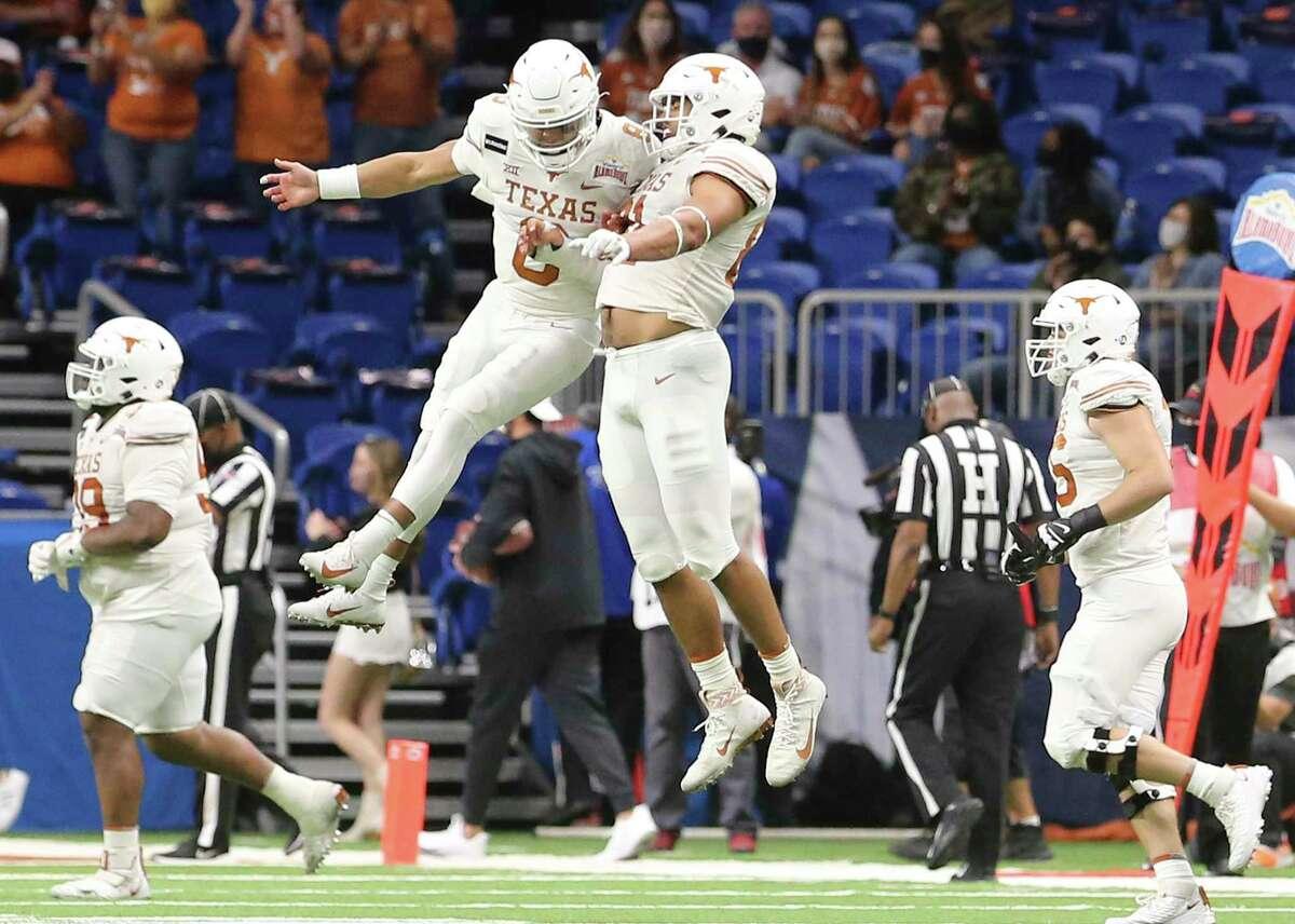 Texas quarterback Casey Thompson (08) celebrates a score with teammate Reese Leitao (81) against Colorado during the 2020 Valero Alamo Bowl at the Alamodome on Tuesday, Dec. 29, 2020.