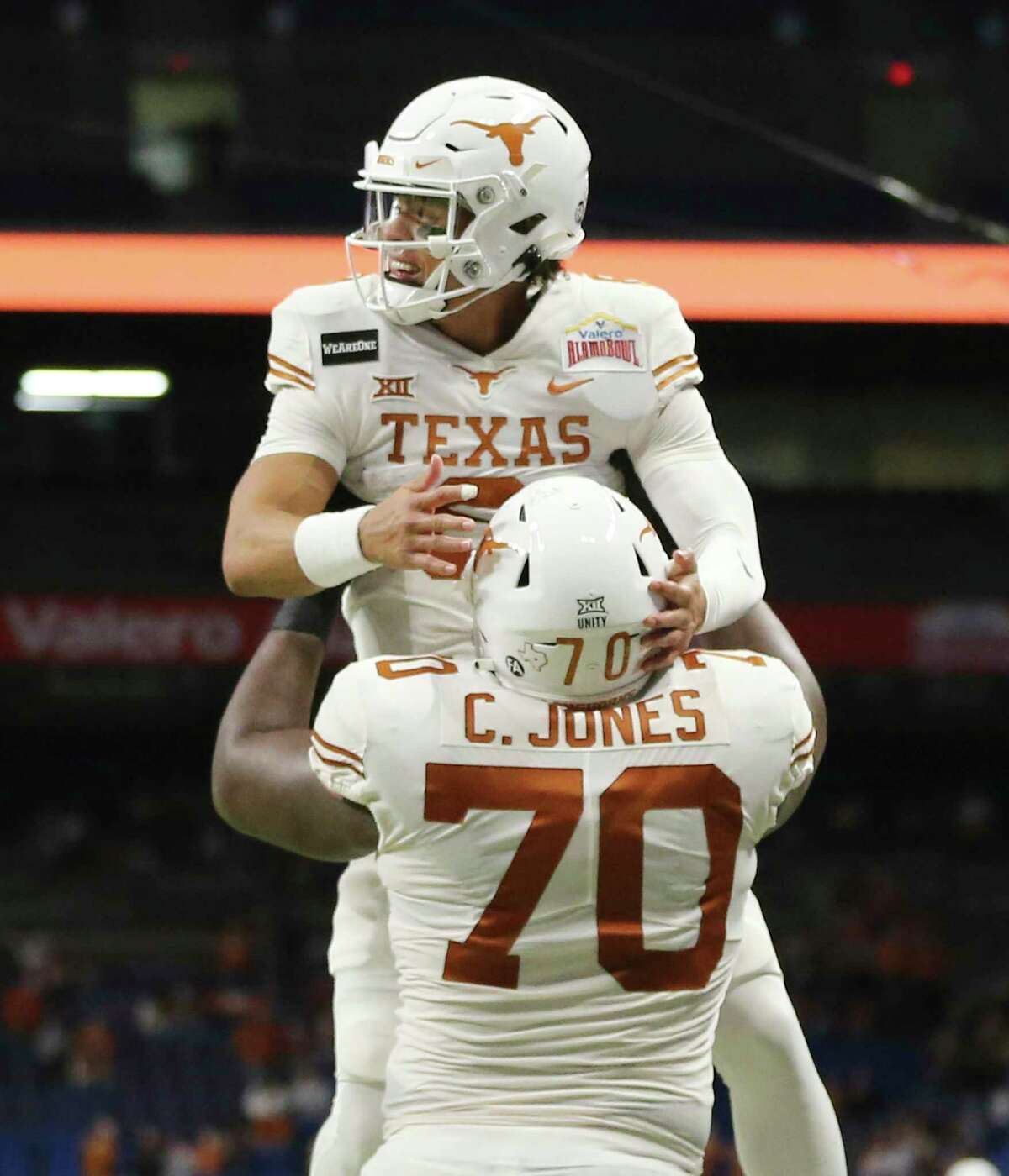 Texas quarterback Casey Thompson (08) gets lifted up by teammate Christian Jones (70) after a team touchdown against Colorado during the 2020 Valero Alamo Bowl at the Alamodome on Tuesday, Dec. 29, 2020.