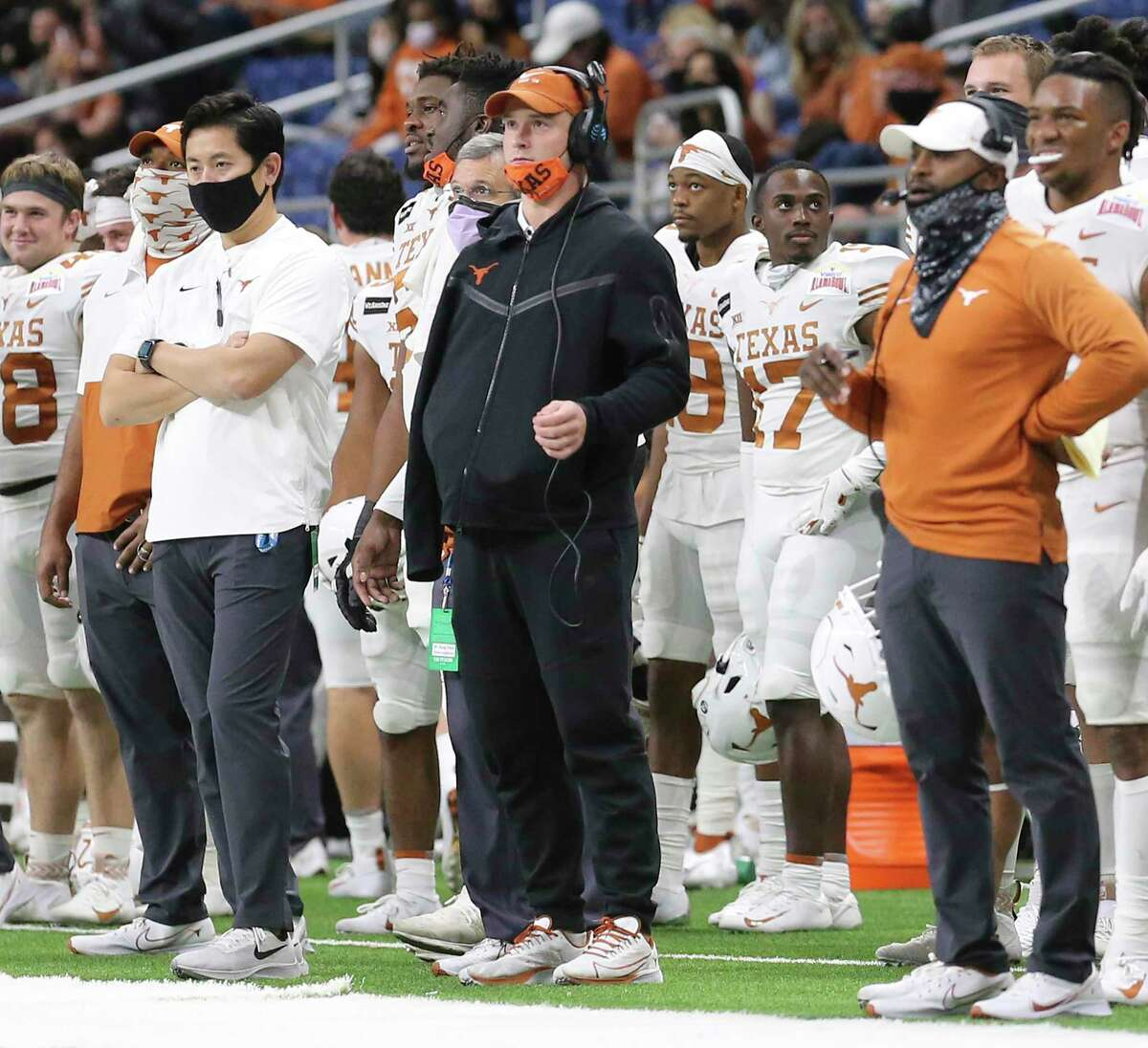 Texas quarterback Sam Ehlinger (center) watches his teammates play against Colorado in the fourth quarter during the 2020 Valero Alamo Bowl at the Alamodome on Tuesday, Dec. 29, 2020.