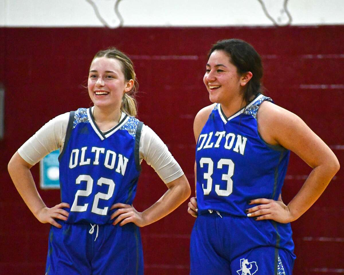 Juniors Karla Arriola (33) and Shaylee Leathers are trying to help the Olton girls basketball team redefine what being a member of the Fillies means by smiling through the good and the bad.