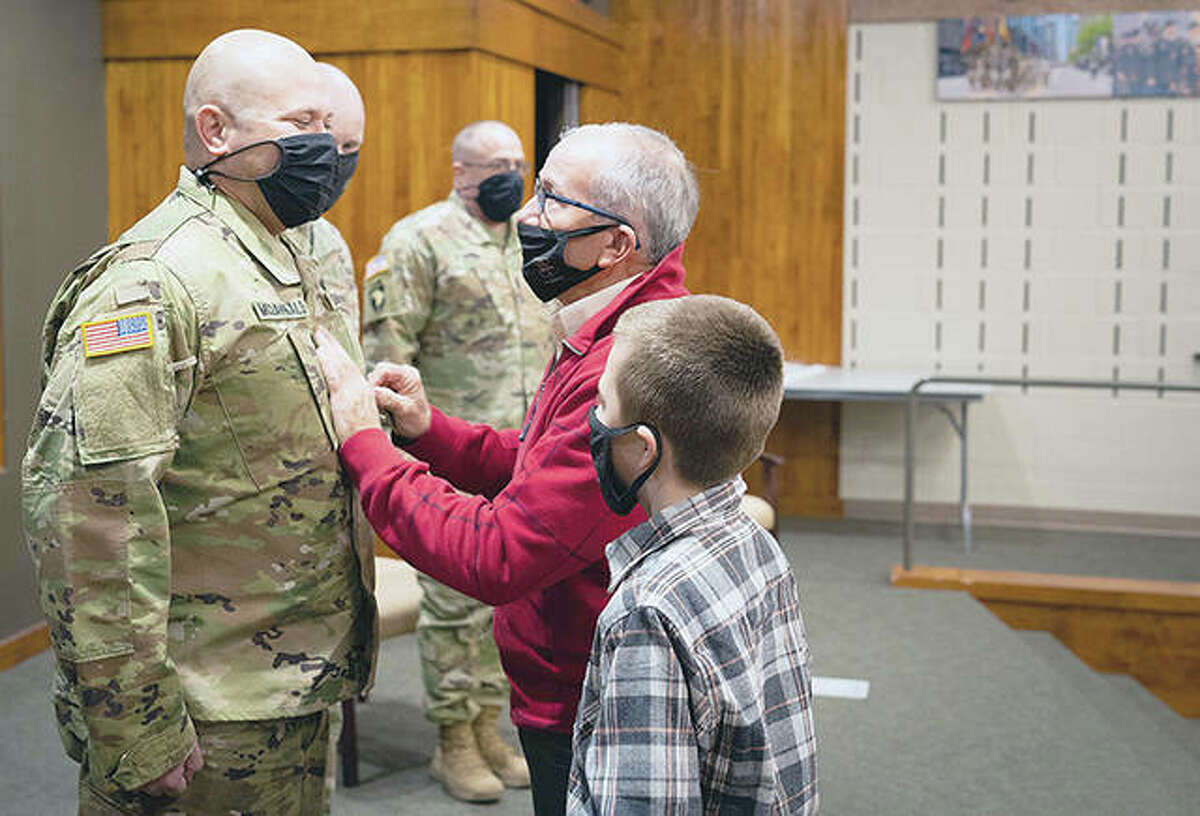 Chad W. McDannald of Franklin is pinned by his father, Terry McDannald, and stepson, Carson Ward, during his promotion to sergeant major at Camp Lincoln in Springfield. McDannald is the operations sergeant major for the Recruiting and Retention Battalion in Springfield.