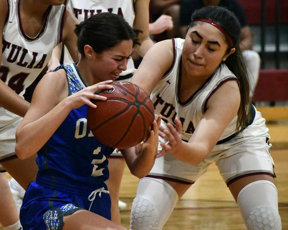 Olton's Celestte Ramirez (2) and Tulia's Vivianna Ramirez battle for the ball during their non-district girls basketball game on Tuesday afternoon at Tulia. Photo: Nathan Giese/Planview Herald