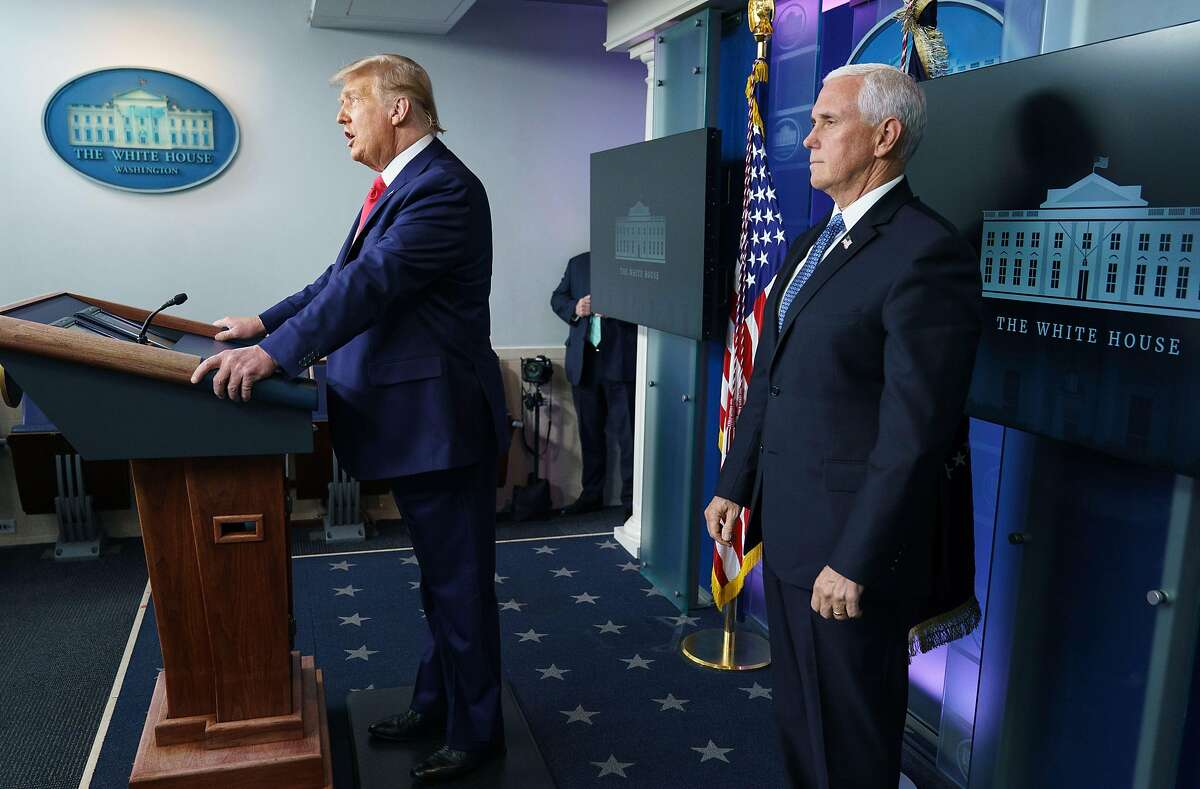 President Donald Trump with Vice President Mike Pence, right, delivers remarks on the stock market during an unscheduled appearance in the Brady Briefing Room of the White House in Washington, D.C., on Nov. 24, 2020.