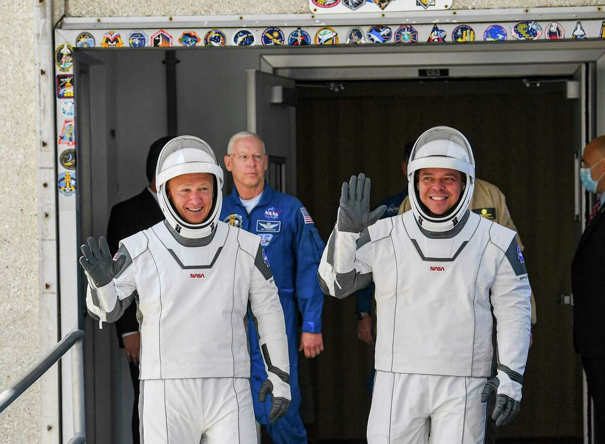 Astronauts Doug Hurley, left, and Bob Behnken on their way to their May flight to the International Space Station. SpaceX is expected to launch NASA astronauts to space twice in 2021.