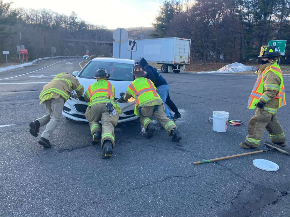 Firefighters handle a crash in Beacon Falls, Conn., on Tuesday, Dec. 29, 2020.