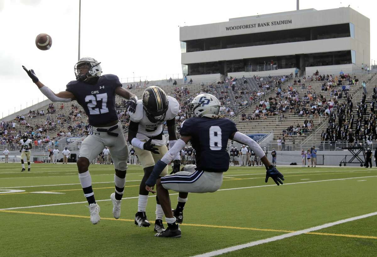 College Park defensive back Curt Evangelister (27) intercepts a tipped pass intended for Conroe wide receiver Louis Williams III (3) during the second quarter of a District 13-6A high school football game at Woodforest Bank Stadium, Saturday, Nov. 14, 2020, in Shenandoah.