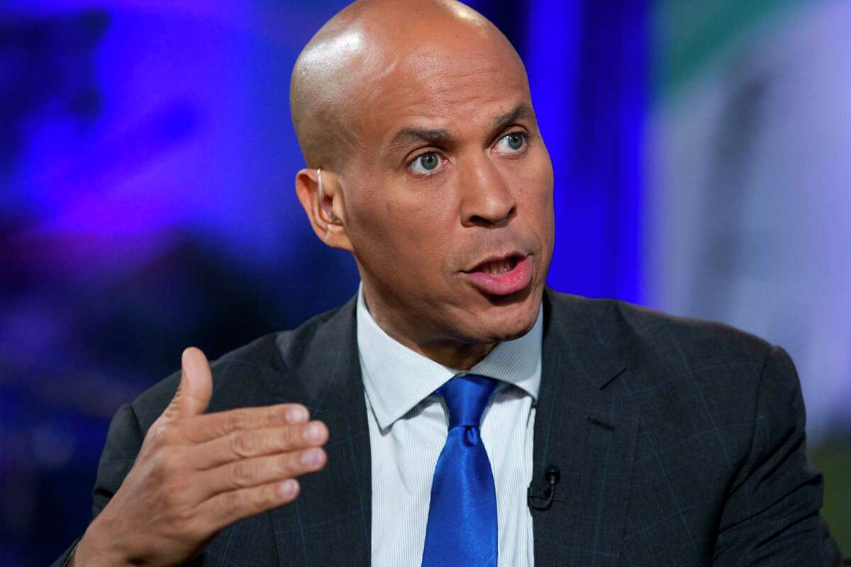 U.S. Sen. Cory Booker, pictured here in 2019, has introduced the ambitious College Athletes Bill of Rights, which would pave the way for basketball and football players to be compensated.