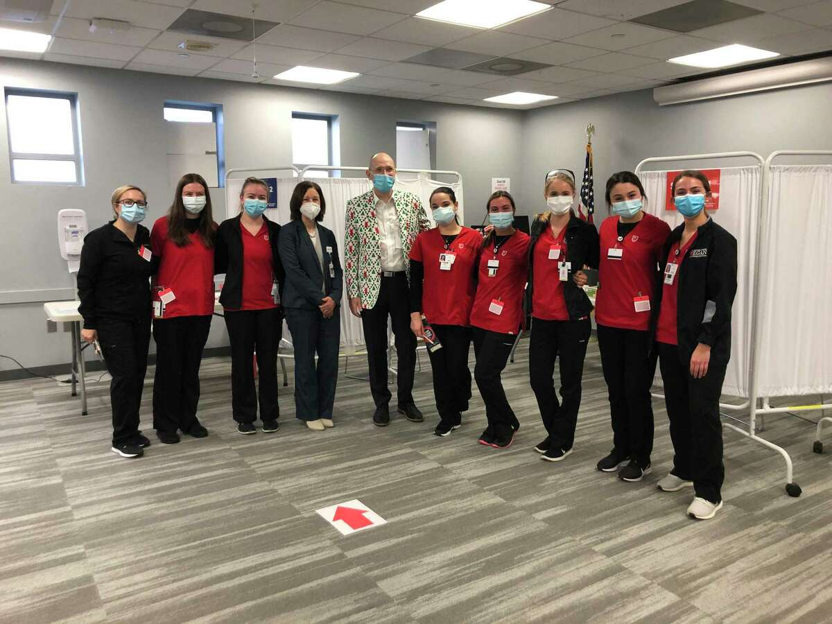 Senior nursing students from Fairfield University along staff from the Norwalk Hospital at its COVID-19 vaccination clinic.