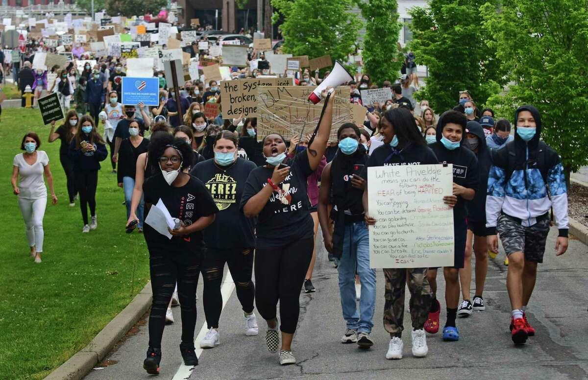 Several former and current Staples High School students organize a group of close to 1000 protestors Friday, June 5, 2020, in downtown Westport, Conn. The group marched from the Post Road bridge to the police station in a peaceful protest against police brutality.