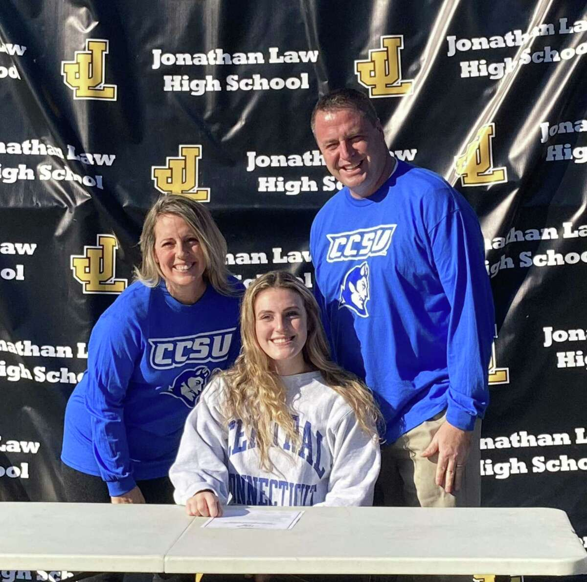 Law volleyball standout Alexis Neider is joined my parents John and Kelly when she signed to play for Central Connecticut State University in the Division I Northeast Conference.