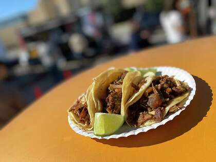 Carnitas tacos made with a mixture of cuts of pork called assortment are popular at Carnitas Don Raúl, a food trailer that specializes in Mexican-style carnitas from Michoacán on Broadway.
