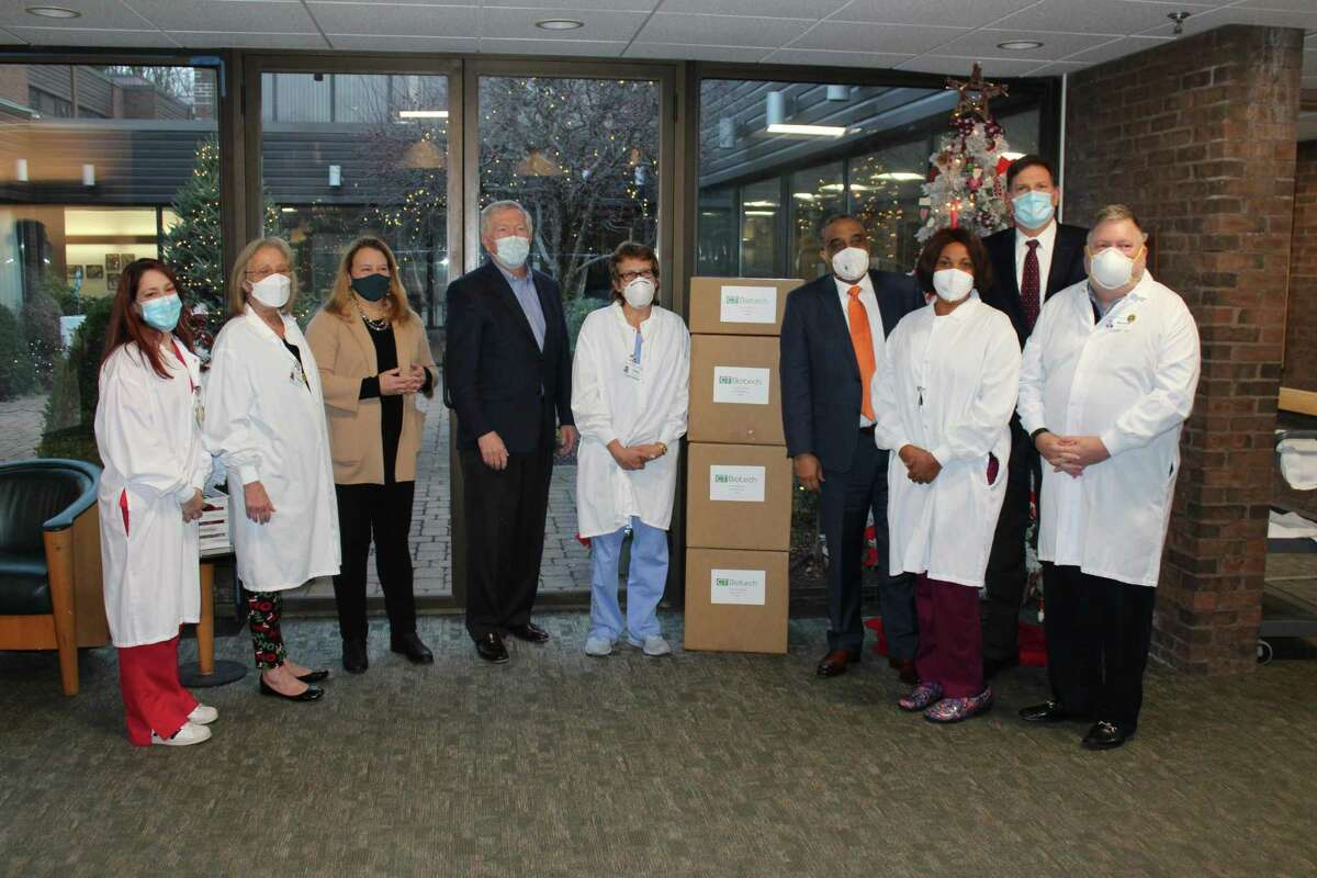 Connecticut Biotech donated 1,000 N95 masks to front line senior care and skilled nursing staff at Waveny LifeCare Network on Dec. 9. The donation was the first of several planned during the month by the company, according to Managing Director Bruce Morris. On hand to accept the gift were Jessica Aleixo, RN, Admissions Coordinator; Claudia Katz, RN, Director of Nursing; state Rep. Lucy Dathan (D-Norwalk and New Canaan); New Canaan First Selectman Kevin Moynihan; Laura Carreau, RN; Morris; CeCe Michel, RN; statre Rep. Tom O'Dea (R-New Canaan and Wilton), and Russell R. Barksdale Jr., president and CEO of Waveny LifeCare Network.