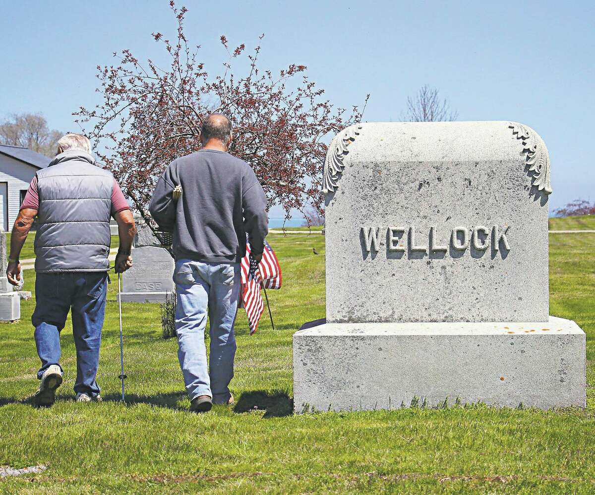 Veterans from the American Legion Post 197 and VFW Post 9344 gathered to place flags at the graves of deceased veterans at some area cemeteries in Harbor Beach May 21. (Mark Birdsall/Tribune File Photo)