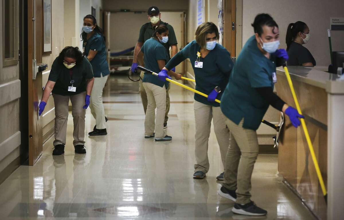 After a covid patient was wheeled to a room the Environmental Services team disinfected the pathway that was taken at the Northeast Baptist Hospital Covid Unit, on Friday, April 24, 2020.