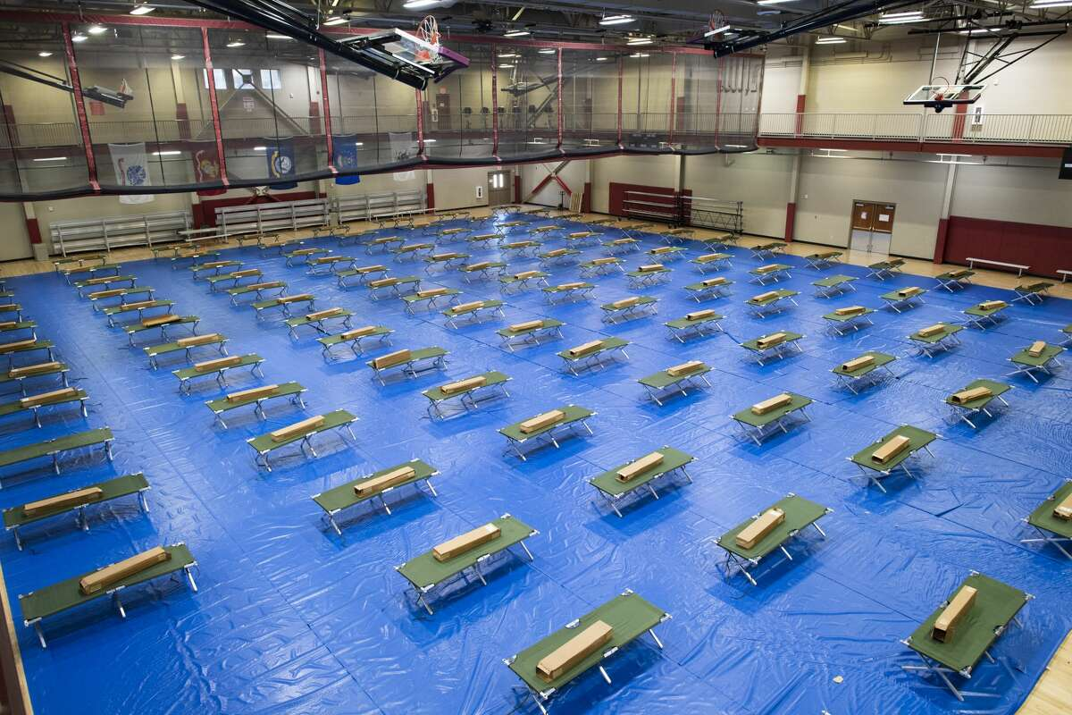A gym at JBSA-Ft. Sam Houston has been equipped with cots just in case they are needed to handle patients in the coronavirus pandemic on Wednesday, March 25, 2020.