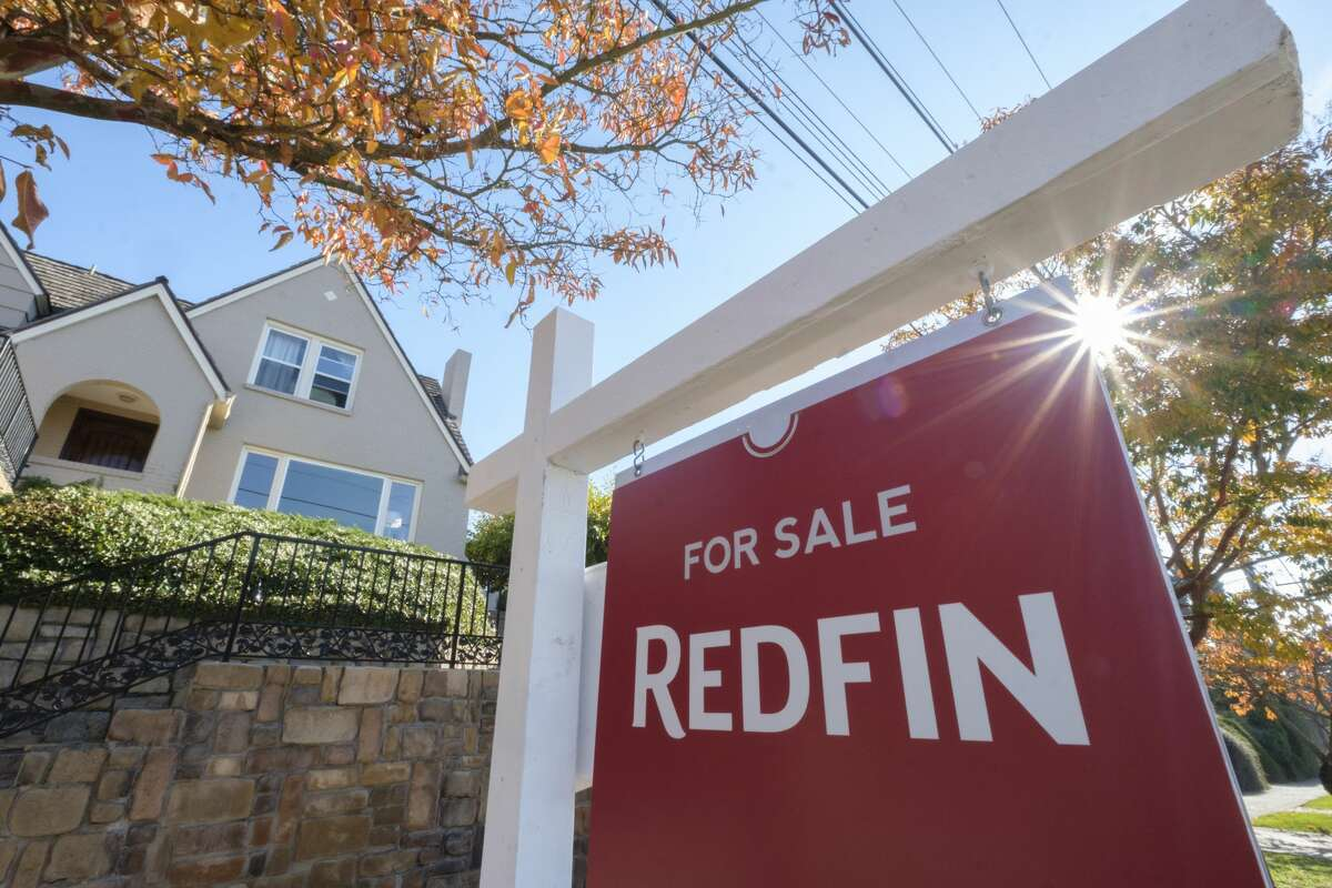 SEATTLE, WA - OCTOBER 31: A Redfin real estate yard sign is pictured in front of a house for sale on October 31, 2017 in Seattle, Washington. Seattle has been one of the fastest and most competitive housing markets in the United States throughout 2017. (Photo by Stephen Brashear/Getty Images for Redfin)