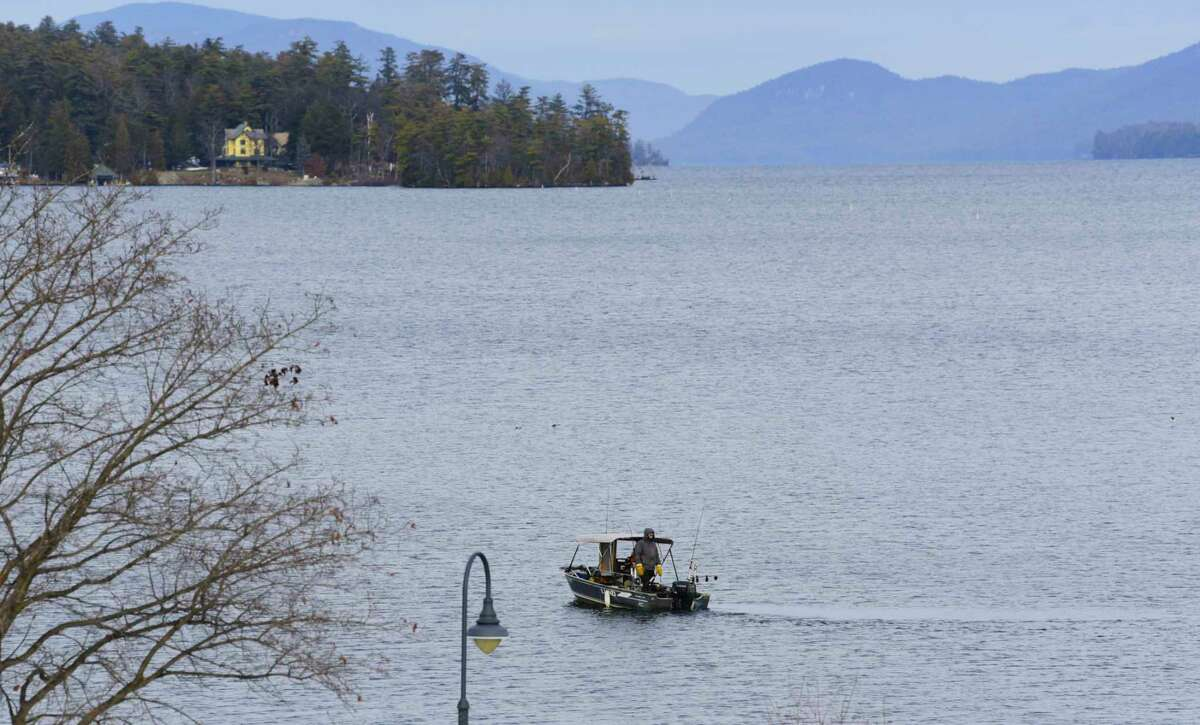 Two people fish from a boat on the southern end of Lake George on Wednesday, Dec. 30, 2020, in Lake George, N.Y. (Paul Buckowski/Times Union)