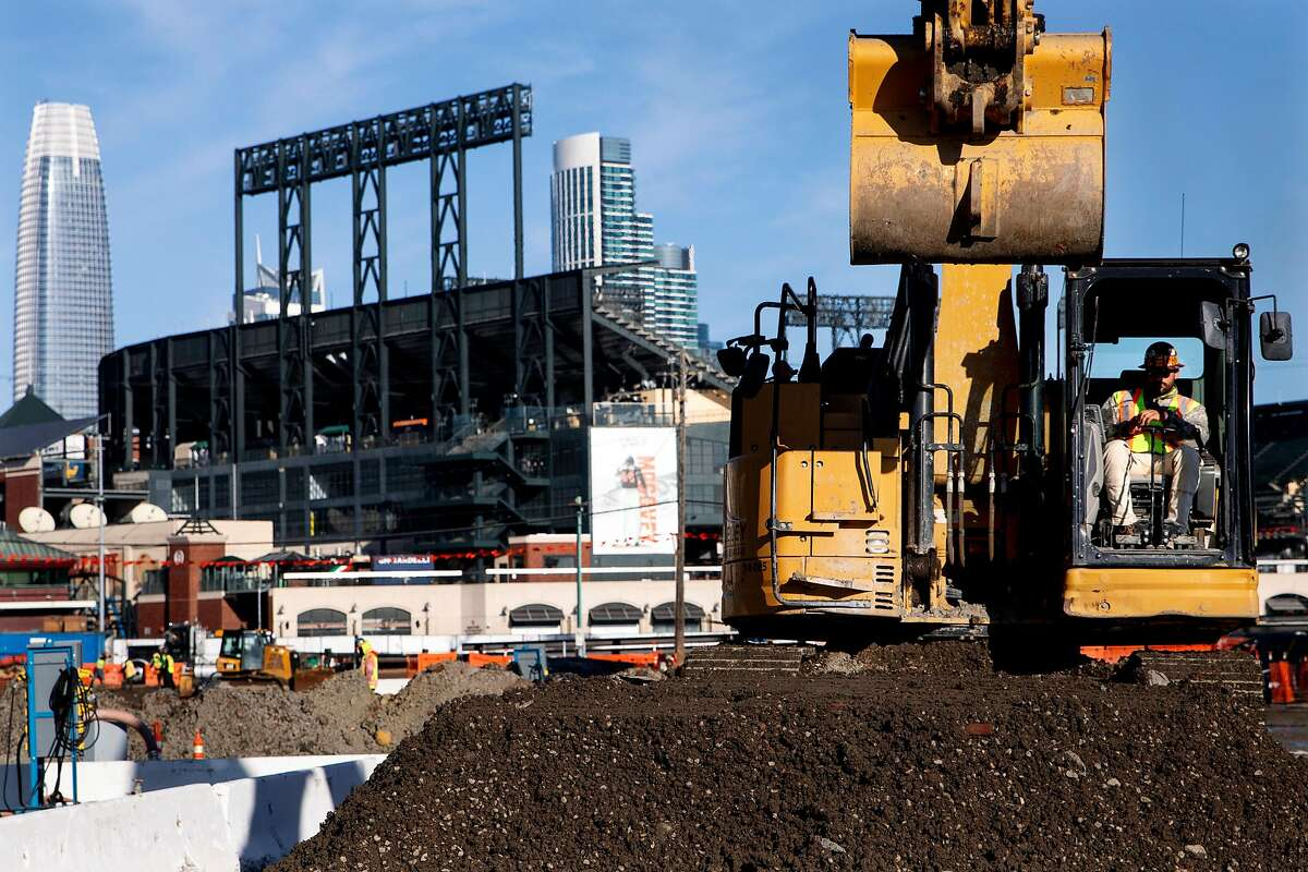 A construction worker takes a break in a tractor at the Mission Rock development along Third Street in San Francisco.