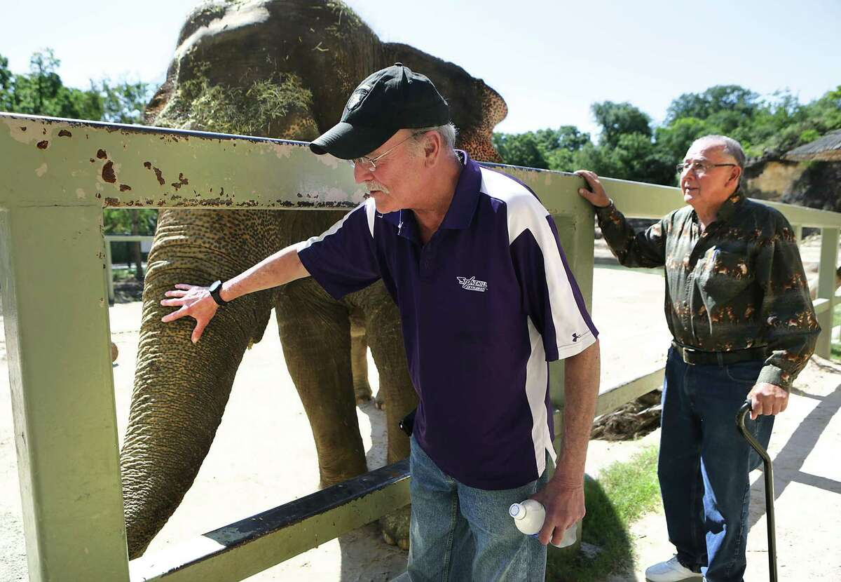 Keith Hodges, center, who has stage 4 lung cancer, worked at the zoo for a year with Lucky the elephant and got to reunite with Lucky and Raymond Figueroa, the San Antonio Zoo's former elephant handler that worked with Lucky and Hodges, on Monday, June 6, 2016.