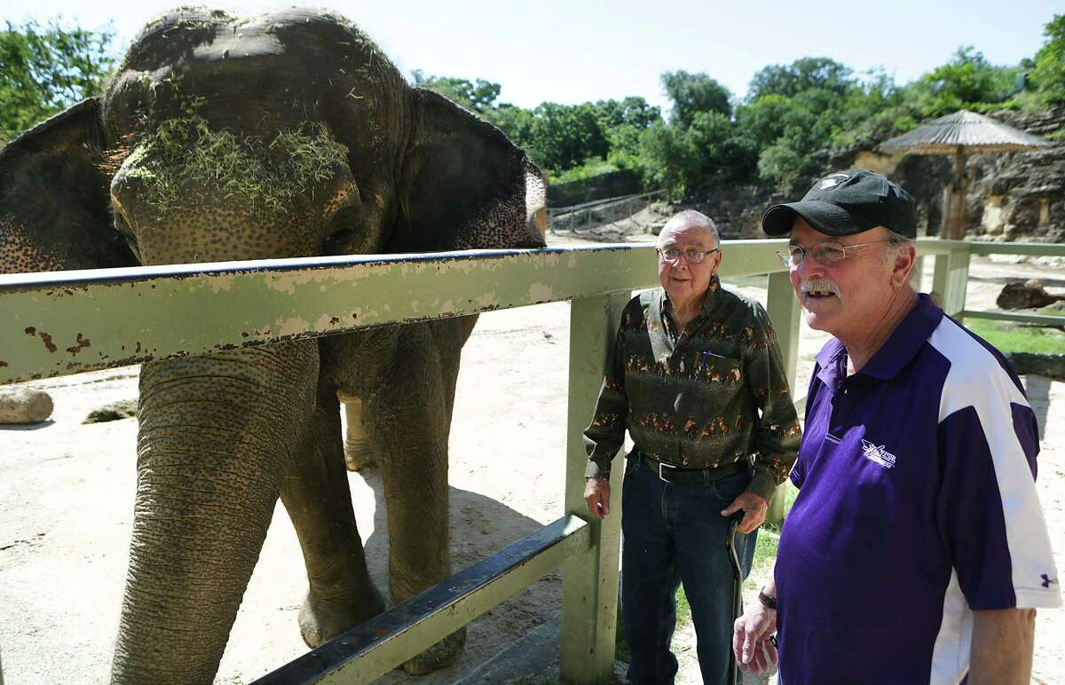 Keith Hodges, right, who has stage 4 lung cancer, worked at the zoo for a year with Lucky the elephant. Hodges got to reunite with Lucky and Raymond Figueroa, the San Antonio Zoo's former elephant handler that worked with Lucky and Hodges, on Monday, June 6, 2016.