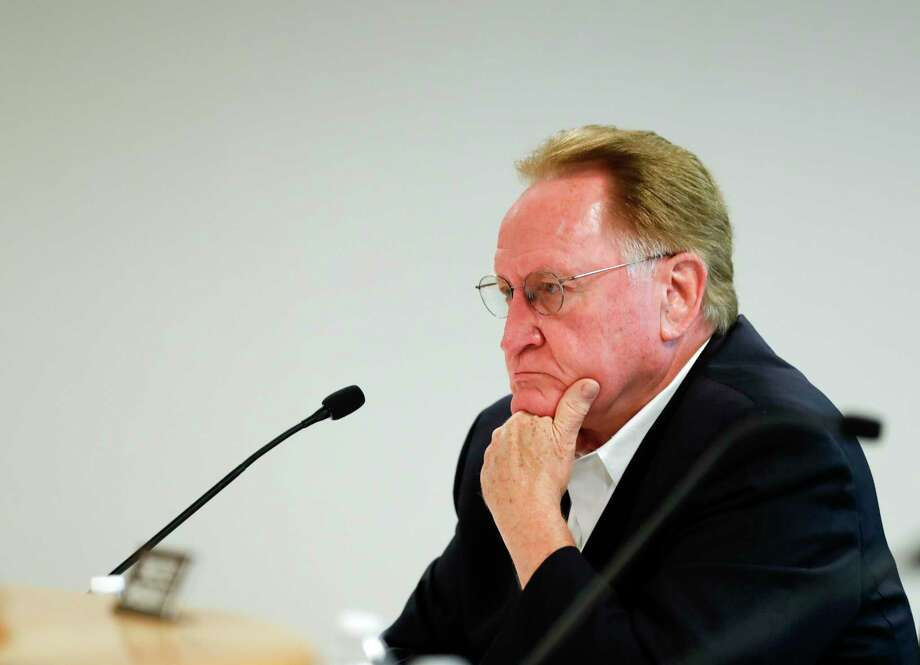 """Montgomery County Judge Mark Keough listens to County Attorney B.D. Griffin after giving his thoughts on Texas Governor Greg Abbott's guidelines to reopen businesses during a Montgomery County Commissioners Court meeting, Tuesday, April 28, 2020, in Conroe. The court pushed back on Abbott's press conference, calling the guidelines """"uncommonly vague"""" and """"confusing."""" Photo: Jason Fochtman, Houston Chronicle / Staff Photographer / 2020 © Houston Chronicle"""