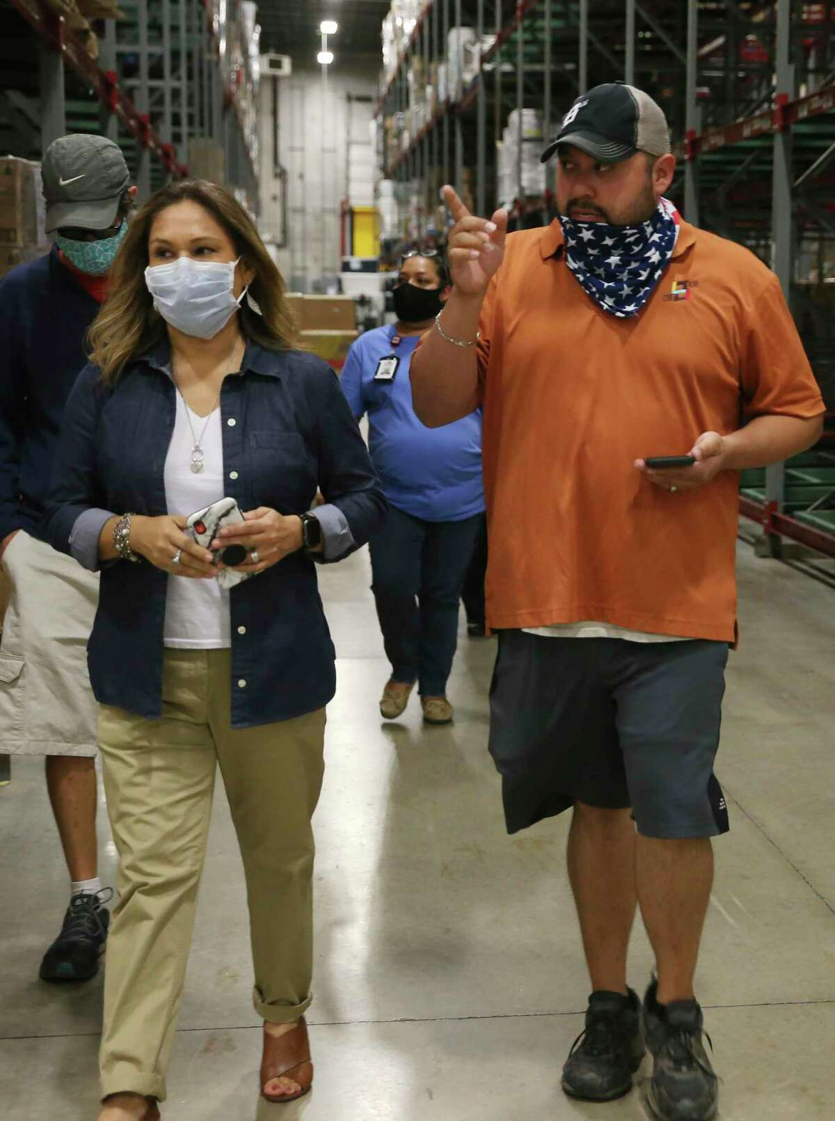 CRE8AD8 owner Gregorio Palomino walks out of the San Antonio Food Bank after five pallets of food boxes were delivered on Thursday, May 28, 2020.
