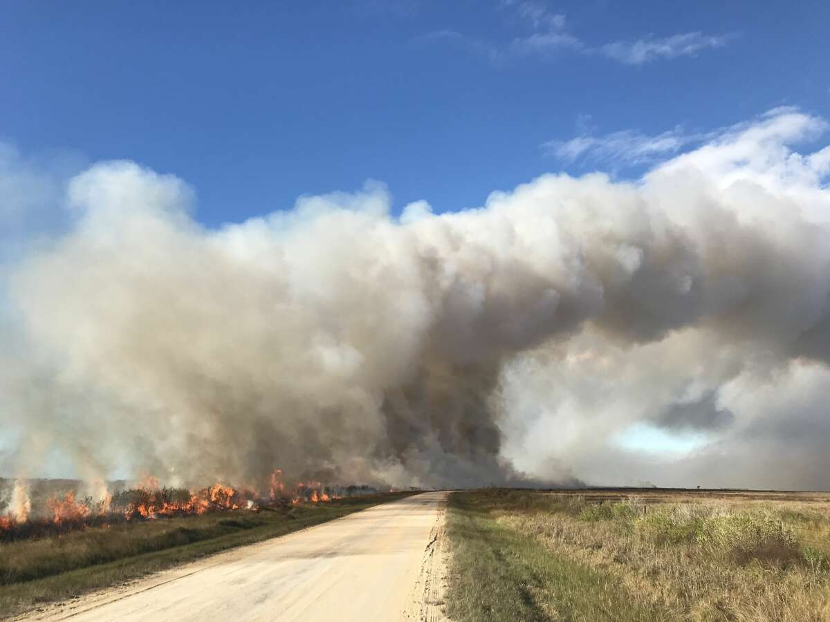 A wildfire burns at Anahuac National Wildlife Refuge on Dec. 10, 2020.