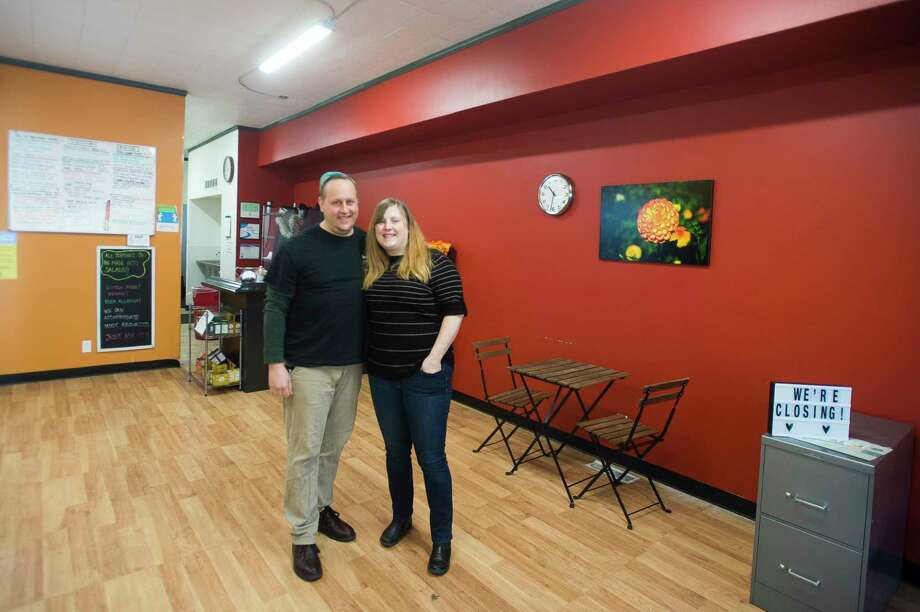 Mike Horvath, left, and Kara Bingham, right, pose for a portrait Tuesday morning inside their restaurant, Good to Go. The brick-and-mortar restaurant will be open for the last time today, while the owners work to transition to a food truck. (Katy Kildee/kkildee@mdn.net)