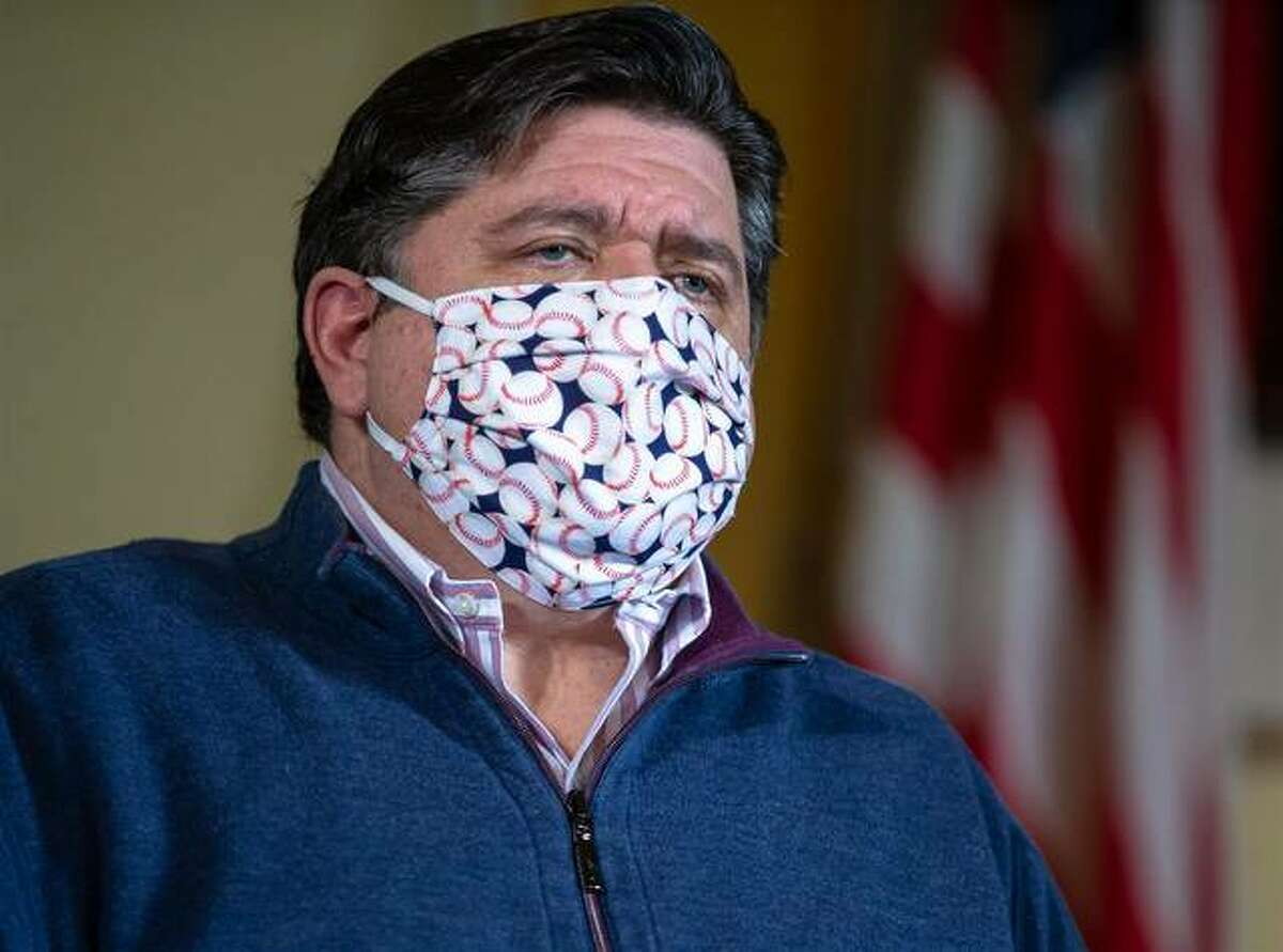 FILE - Gov. J.B. Pritzker faces a number of questions from news media throughout the state May 21 on issues ranging from youth sports activities to worship services. He gave his daily COVID-19 press briefing from his office at the Capitol in Springfield.