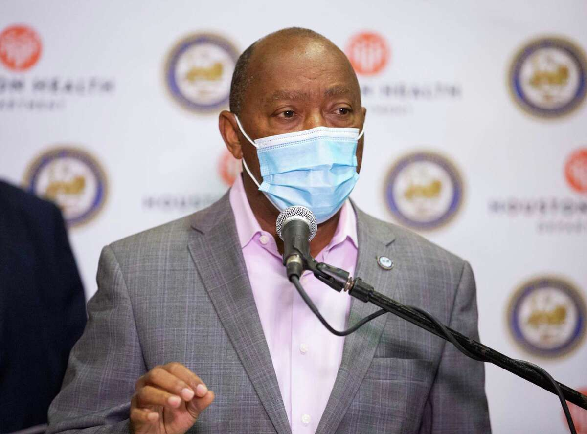 Houston Mayor Sylvester Turner encourages citizens to stay away from traditional New Year's celebration during the COVID-19 pandemic during a press conference Monday, Dec. 28, 2020, at a Harris Health clinic in Houston.