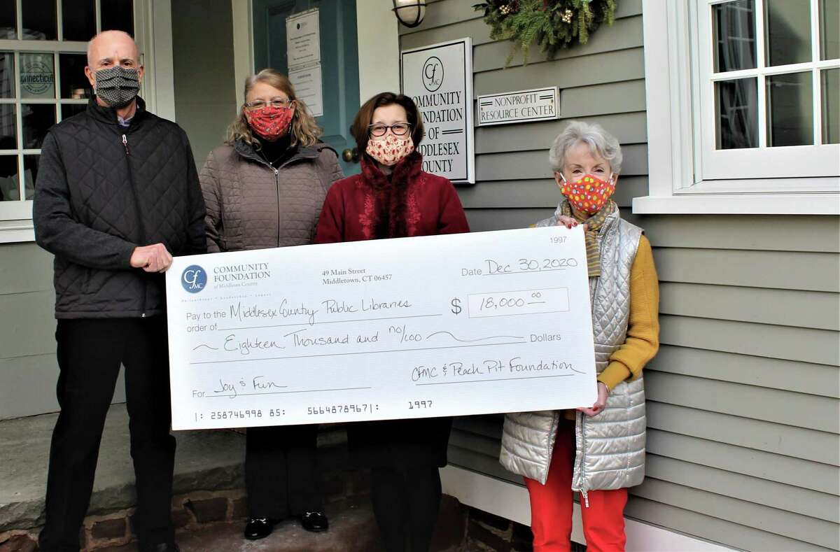 From left, Community Foundation of Middlesex County Board of Directors Chairman John Boccalatte, Director of Finance Jennifer Hintz, Thayer Talbott, vice president of Programs & Operations, and President and CEO Cynthia Clegg are shown at the 49 Main St. Middletown office.